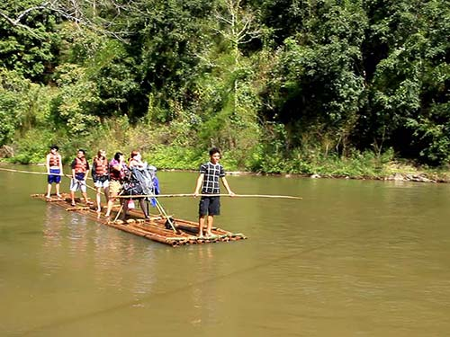 Wooden rafts going down the river.