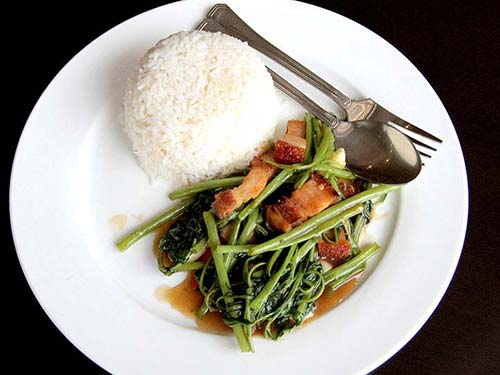 Thai stir-fried morning glory with bacon.