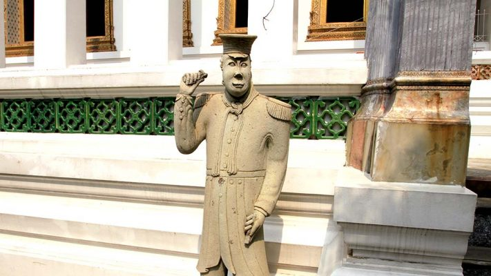 Statue of a soldier in the courtyard of Wat Suthat Thepwararam.