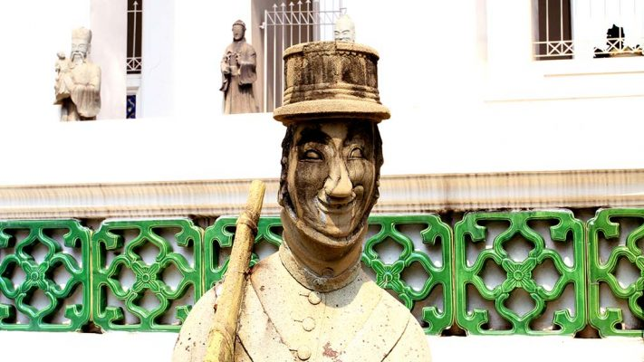 Close-up of the statue of a soldier in the courtyard of Wat Suthat Thepwararam.